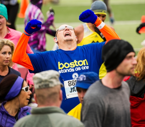 Jack Sheard of Grand Island, NE celebrates after crossing the finish line, completing the Lincoln Marathon at Memorial Stadium. KRISTIN STREFF/Lincoln Journal Star
