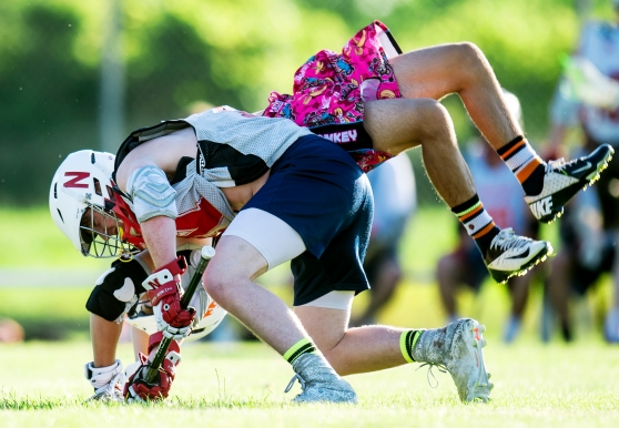Lincoln Rampage current player Rudy Longoria does a flip over former player Tom Gillan (white) at a face-off during an alumni scrimmage at Abbott Sports Complex in Lincoln. KRISTIN STREFF/Lincoln Journal Star