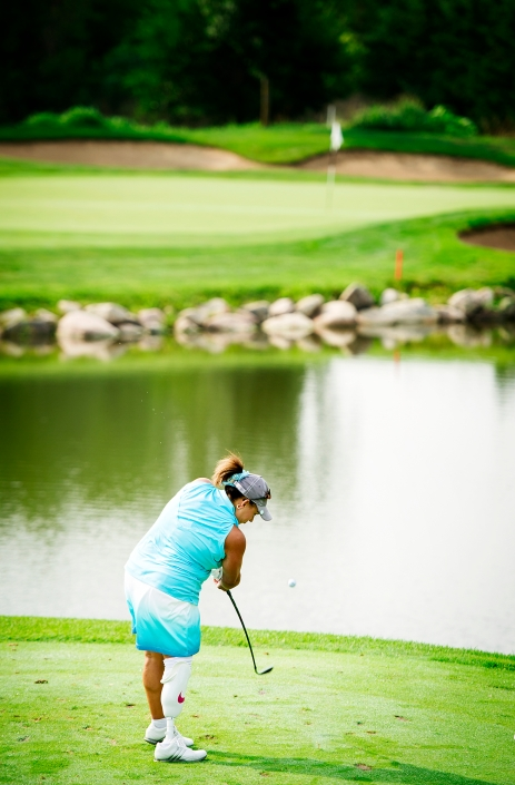 Mandi Sedlak of Kearney, Neb. tees off on Hole 4 during the second round of the 65th Annual National Amputee Golf Association Championship at Wilderness Ridge Golf Club in Lincoln. KRISTIN STREFF/Lincoln Journal Star