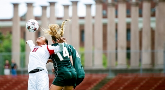 Nebraska forward Mayme Conroy takes a header in front of two Michigan State defenders during the second half at the Nebraska Soccer Field in Lincoln. KRISTIN STREFF/Lincoln Journal Star
