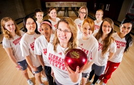 Nebraska junior Liz Kuhlkin (center) hopes to lead the NU women's bowling team to their fifth NCAA national championship this season. Team members include (front, from left) Emily Nykiel, Yan Ling, Gazmine Mason, Lizabeth Kuhlkin, Jessica Eberly, Andrea Ruiz, Alexandra Mosquera, (back, from left) Amanda Burau, Bethany Hedley, Briana Zabierek, and April Campbell. Photographed at the East Campus Lanes. KRISTIN STREFF/Lincoln Journal Star