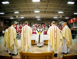 """Accompanied by eight other celebrants from the Lincoln catholic diocese, the most reverend bishop James Conley (center) leads the """"Grandparents Day"""" all-school mass during Catholic Schools Week at Bishop Neumann High School. KRISTIN STREFF/Lincoln Journal Star"""