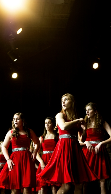"""The Bishop Neumann show choir, the Scarlet Knights, perform during the """"Grandparents Day"""" program at Bishop Neumann High School. The program followed an all-school mass given by the Most Reverend Bishop James Conley in celebration of Catholic Schools Week. KRISTIN STREFF/Lincoln Journal Star"""