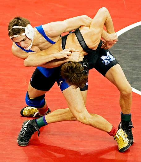 O'Neill junior Cory Rowse (left) and Malcolm senior Mason Glause tangle during a 145-pound quarterfinal match in the Class C State Wrestling Championships at the CenturyLink Center in Omaha. KRISTIN STREFF/Lincoln Journal Star