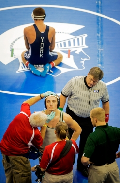 Omaha Skutt Catholic senior Jake Walker has trainers tend to a injury as his opponent Troy Taylor (top) of York waits during a 152-pound quarterfinal match in the Class B State Wrestling Championships at the CenturyLink Center in Omaha. KRISTIN STREFF/Lincoln Journal Star
