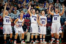 Minden players Jenna Denney (from left), Brooke Kissinger, Jamie Kissinger, Alison Rowse, and Rebecca Stewart celebrate their victory over Platteview in the final seconds of a class C-1 girls state basketball tournament semifinal game at Pinnacle Bank Arena. KRISTIN STREFF/Lincoln Journal Star