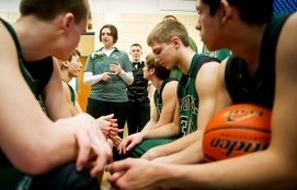 Clearwater/Orchard head coach Shelly Minarik encourages her team in the locker room before the start of a class D-1 boys state basketball tournament first round game against North Platte St. Patrick's at Lincoln East. KRISTIN STREFF/Lincoln Journal Star