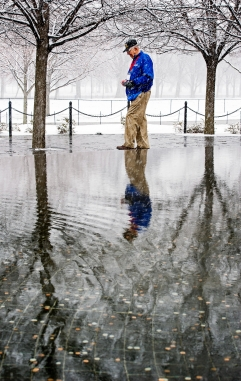 Korean war veteran Don Klute of Bradshaw, Neb. takes a moment in remembrance as he walks along the reflecting pool at the Korean War Veterans Memorial on the National Mall. KRISTIN STREFF/Lincoln Journal Star