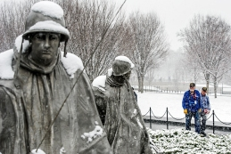 Korean war veterans from Nebraska participating in the Korean War Honor Flight pause to admire the triangular field of stainless steel statues at the Korean War Veterans Memorial. KRISTIN STREFF/Lincoln Journal Star