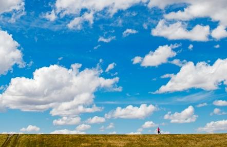 Walkers enjoy warmer spring temperatures under a bright blue sky at Holmes Lake. KRISTIN STREFF/Lincoln Journal Star