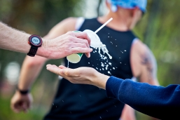 A runner snags a cup of Gatorade out of the hand of volunteer Caleb White during the Lincoln National Guard Marathon & Half Marathon near the five-mile mark along 48th Street. KRISTIN STREFF/Lincoln Journal Star
