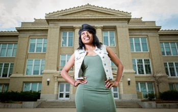 Je'Kerra Hopper looks to the future with aspiration on the front steps of her alma mater, Lincoln High School. Having overcome both of her parents' incarcerations, losing her grandmother, and having been raised solely by her grandfather, Hopper has earned a full ride scholarship to Peru State College to study criminal justice and will be the first member of her family to attend college. KRISTIN STREFF/Lincoln Journal Star