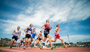 Runners round the first turn at the start of the Class B 3,200-meter run finals on the opening day of the state track and field championships at Omaha Burke Stadium. KRISTIN STREFF/Lincoln Journal Star
