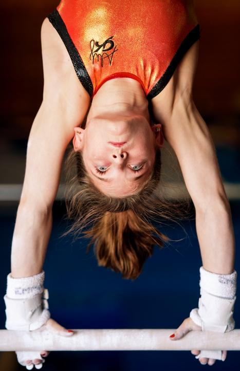 Elite gymnast Jordan Bowers, 11, practices on the uneven bars at Solid Rock Gymnastics. KRISTIN STREFF/Lincoln Journal Star