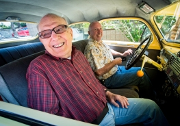Nostalgic for his first car, 91-year-old birthday boy Roy Standen (left) gets a ride from Boyd Ready in a restored 1947 Plymouth courtesy of the team at Family & Implant Dentistry on S 4th St. and Rebels Auto Club. KRISTIN STREFF/Lincoln Journal Star