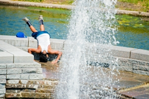 Braving the near 100-degree heat, Kyree Ware, 14, of Lincoln dips his head into Windstream Fountain to cool off along Antelope Valley. KRISTIN STREFF/Lincoln Journal Star
