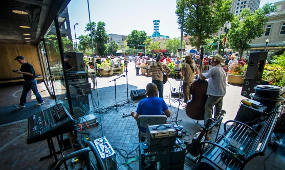 Jack Hotel performs just outside the south windows of Wells Fargo Bank as part of the Hear Lincoln summer concert series at 13th and O streets. KRISTIN STREFF/Lincoln Journal Star