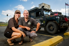World travelers Jayne Wilkinson and David Turner smile for a portrait next to their Land Rover outside the Lincoln Luxury Inn. On a worldwide adventure, the couple made a stop in Lincoln after criss-crossing six continents and exploring more than 50 nations in their custom-built Land Rover, which they call Lizzybus. KRISTIN STREFF/Lincoln Journal Star