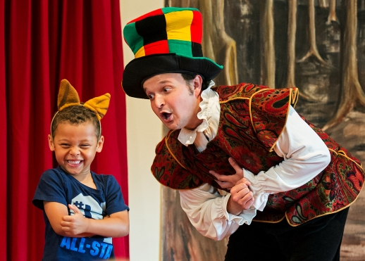 Shane Miller (right) of the Hampstead Stage Company, a not-for-profit organization out of New Hampshire, performs as the Mad Hatter next to audience member Braylon Kelley, 4, acting as the Cheshire Cat, during an afternoon production of Alice in Wonderland at the Bennett Martin Library. The Hampstead Stage Company, one of the largest educational touring companies in the country, performs more than 2,000 plays each year for young audiences, including two separate performances for the Lincoln City Libraries Summer Reading Program. KRISTIN STREFF/Lincoln Journal Star