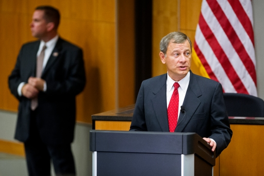 Under the attentive watch of the United States Marshall Service, chief justice of the United States John G. Roberts, Jr. addresses a room filled with dignitaries, faculty, staff, and students in Hamann Auditorium at the University of Nebraska-Lincoln College of Law. KRISTIN STREFF/Lincoln Journal Star