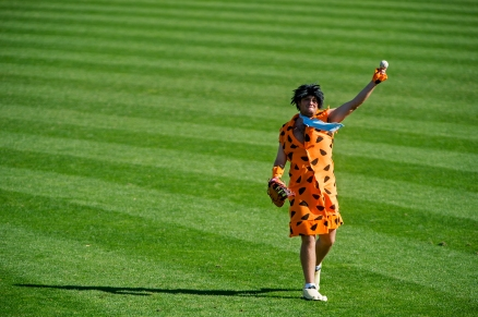 Dressed as Fred Flinstone, Nebraska player Benjamin Miller warms up before the start of the Huskers' Red vs. White exhibition game at Haymarket Park. KRISTIN STREFF/Lincoln Journal Star