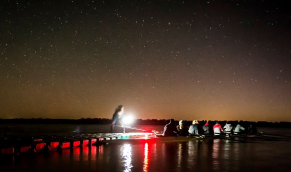 Members of the University of Nebraska crew team dock during an early morning crew practice at Branched Oak Lake. KRISTIN STREFF/Lincoln Journal Star