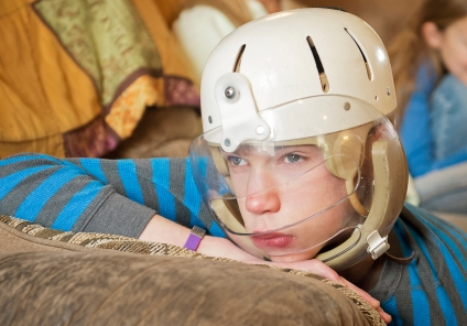 Will Gillen, 12, looks out the living room window just before settling in for an afternoon nap at his home in Bellevue. Will, who suffers from Lennox-Gastaut syndrome, a severe form of epilepsy resulting in various types of seizures multiple times in a single day, must wear a helmet with an attached faceguard to protect himself from injury. In an effort to legalize the medical use in Nebraska, Will's parents are trying to educate legislators on the benefits of hemp oil extract as treatment for their son's condition. KRISTIN STREFF/Lincoln Journal Star