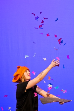 Simone Rau releases paper butterflies during her performance on the opening night of the 60th annual Nite of Knights at Lincoln Southeast High School. KRISTIN STREFF/Lincoln Journal Star