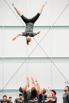 Union College Gymnaire Cassie Smith is tossed into the air by her teammates during a skills rotation at Acrofest at the Speedway Sporting Village. Union College hosted the event, which brought more than 600 gymnasts from 24 high schools and colleges around North America to learn new skills in tumbling, stunting, choreography, aerial acrobatics and more. KRISTIN STREFF/Lincoln Journal Star