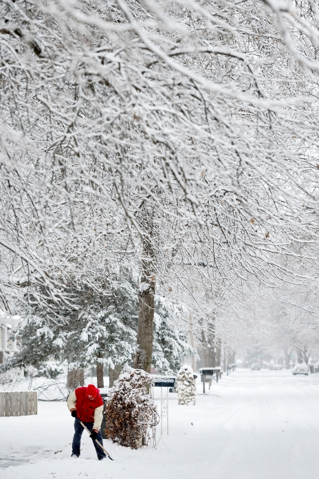 Ash Irons shovels the walk at his mother's house near 40th and Sumner streets. Approximately three inches of snow blanketed Lincoln this afternoon, following a morning of freezing drizzle. KRISTIN STREFF/Lincoln Journal Star