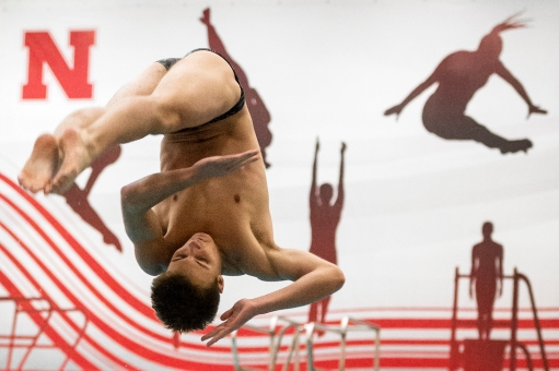 Lincoln Northeast's Aaron Haeffner completes a first-round dive during the boys state diving championships at the Bob Devaney Sports Center in Lincoln. KRISTIN STREFF/Journal Star