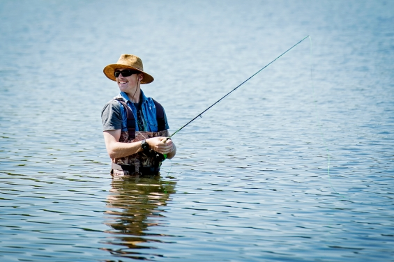 North Star senior Braydon Cox wades into the water during the Lincoln Public Schools' catch-and-release fly-fishing F.I.S.H. tournament sponsored by the National Fishing in Schools Program at Holmes Lake. KRISTIN STREFF/Journal Star