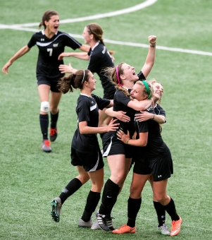 Omaha Skutt Catholic players celebrate as the final seconds tick off the clock of the Class B state soccer championship at Creighton University's Morrison Stadium. The Skyhawks defeated Gretna 3-1 to win the title. KRISTIN STREFF/Journal Star