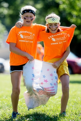 LINCOLN, NEB - 08/03/2016 - Irving summer day camp participants Alexis Bradley, 10 (left), and Kendal Fenton, 12, run in a three-legged sack race during an end-of-summer play day sponsored by Lincoln Parks and Recreation on Wednesday, Aug. 3, 2016, at Woods Park. KRISTIN STREFF, Journal Star
