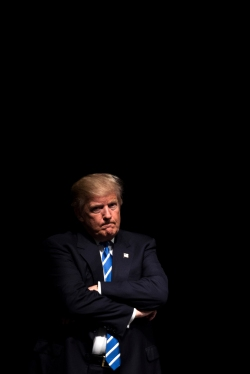 COUNCIL BLUFFS, IA - 09/28/2016 - Republican presidential candidate Donald Trump stands in the shadows before addressing a crowd of supporters during a campaign rally on Wednesday, Sept. 28, 2016, at the Mid-America Center. KRISTIN STREFF, Journal Star