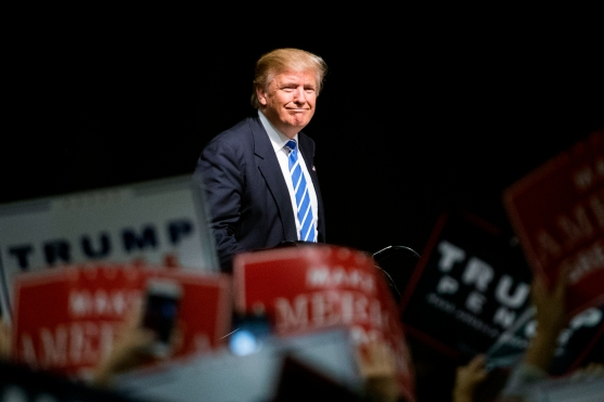 COUNCIL BLUFFS, IA - 09/28/2016 - Republican presidential candidate Donald Trump heads to the stage to address a crowd of supporters during a campaign rally on Wednesday, Sept. 28, 2016, at the Mid-America Center. KRISTIN STREFF, Journal Star