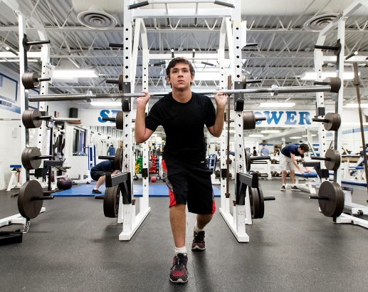 Senior Skyler Stefanski concentrates on his balance and core as he does some barbell lunges during a beginning weight training class at Lincoln East. KRISTIN STREFF, Journal Star