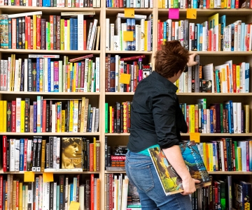 Bookseller Sarah Karjala selects books for a display at the new downtown book store Francie & Finch Bookshop in its 13th street location. KRISTIN STREFF, Journal Star