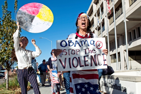 Activist Maria Fortune of Lincoln leads a crowd in a peaceful march protesting the Dakota Access Pipeline outside the Robert V. Denney Federal Building and United States Courthouse. KRISTIN STREFF, Journal Star