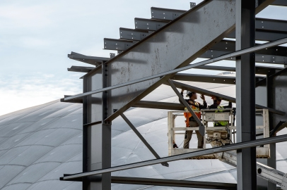 Construction continues as the new indoor tennis facility begins to take shape just to the west of the existing bubbles at Woods Tennis Center. KRISTIN STREFF, Journal Star