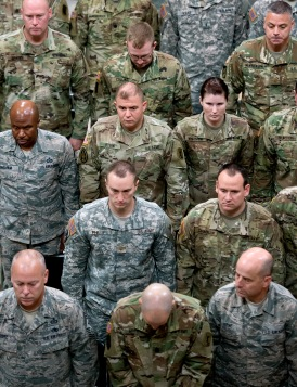 Members of the Nebraska National Guard stand at attention during a celebration commemorating the 380th birthday of the National Guard in the Rotunda at the Capitol. KRISTIN STREFF, Journal Star