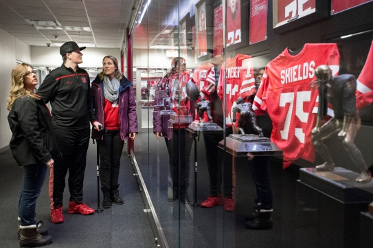 Madonna Rehabilitation Hospital patient Andrew Brockman (center), 17, of West Point, Neb., looks at a tribute to former Husker players with his mom Colleen (left) and therapist April Lieb during a tour of Memorial Stadium at the University of Nebraska. KRISTIN STREFF, Journal Star