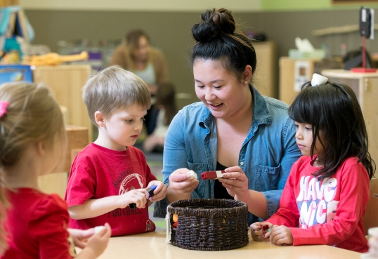 Preschool teacher Theresa Phan (center) works with her students, including Cecilia Solorio (right) and Sawyer Wasserburger, on creating patterns in her classroom at Bright Horizons Family Solutions at Centennial Mall in downtown Lincoln. KRISTIN STREFF, Journal Star
