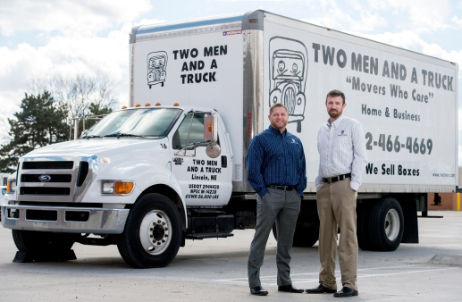Two Men and a Truck co-owners Justin Tangeman (left) and Tyler Whalen stand for a portrait in front of one of their moving trucks outside their office in north Lincoln. KRISTIN STREFF, Journal Star
