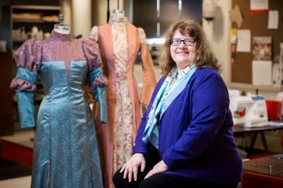 University of Nebraska-Lincoln retiring associate professor and costume designer Janice Stauffer sits for a portrait amid a couple of her Victorian-era creations in the costume shop. KRISTIN STREFF, Journal Star