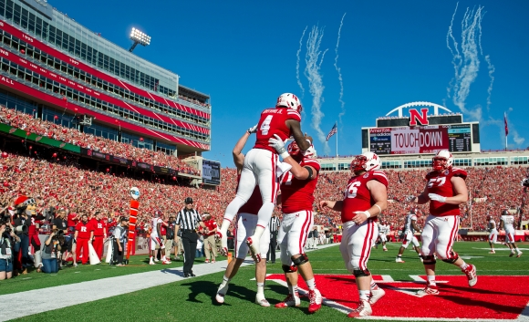 Nebraska celebrates a first quarter touchdown by quarterback Tommy Armstrong Jr. (4) during a game against Rutgers at Memorial Stadium. KRISTIN STREFF/Lincoln Journal Star