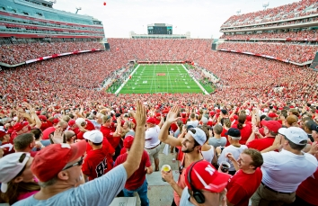 Husker fans in the South endzone celebrate as Nebraska scores its first touchdown against Southern Miss during the first quarter at Memorial Stadium. KRISTIN STREFF/Lincoln Journal Star