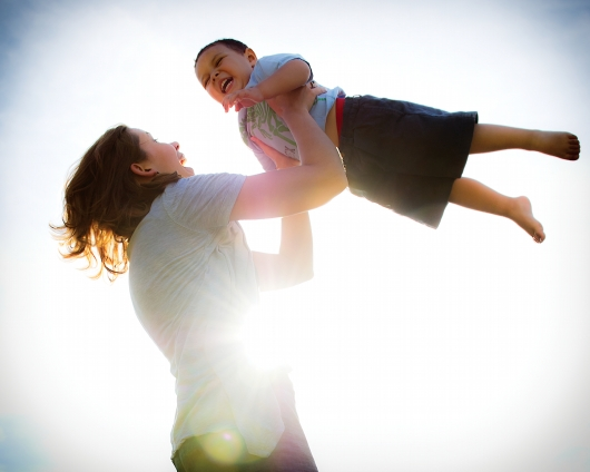 Jenae VanEvery plays with her adopted son, Josiah, 3, in her backyard in Lincoln, NE. The VanEverys began caring for Josiah as foster parents when he was just 5 weeks old before legally adopting him into their family in 2011. (KRISTIN STREFF / For the Juvenile Justice Information Exchange)