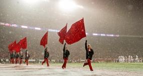 The Nebraska dance team, the Scarlets, run across the field following a fourth quarter touchdown against Wisconsin at Camp Randall Stadium. KRISTIN STREFF/Lincoln Journal Star