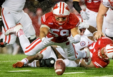 Wisconsin linebacker Marcus Trotter (59) dives on a fumble made by Nebraska running back Ameer Abdullah (8) during the second half at Camp Randall Stadium. KRISTIN STREFF/Lincoln Journal Star